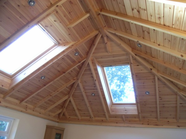 Structural features roof trusses quick ltd for Vaulted ceiling trusses